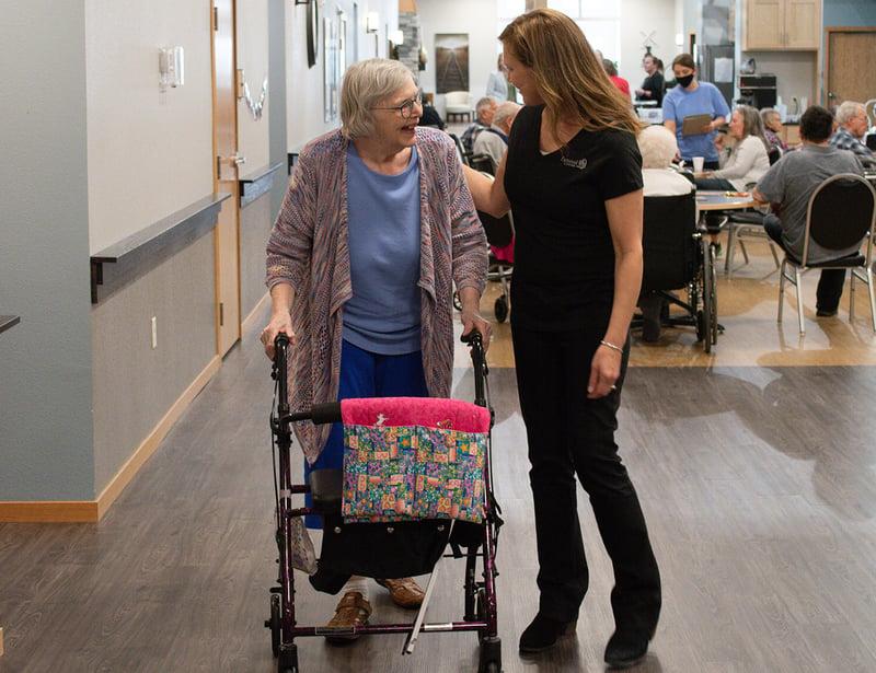 Senior woman with walker caring nurse